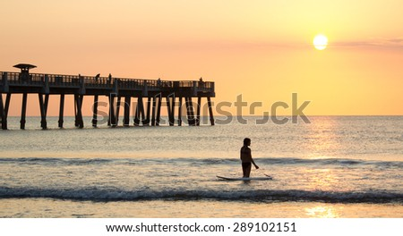Early morning at the pier in Jacksonville Beach, Florida. - stock photo