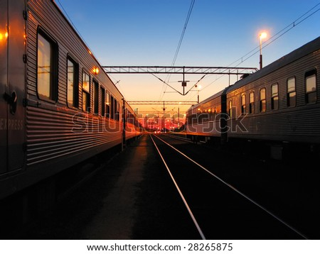 Early morning at the railroad station - stock photo