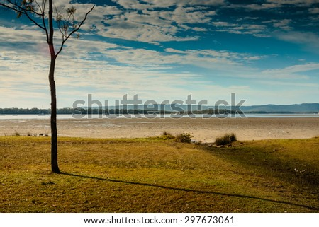 Early morning at Tin Can Bay, Queensland, Australia. We are on our way to feed the wild dolphins. Had to get up early. - stock photo