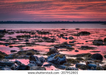Early morning dawn HDR seascape at Sachuest Wildlife Refuge in Middletown, Rhode Island. The sky was naturally pink and red. / Dusk Travel Seascape Background - stock photo