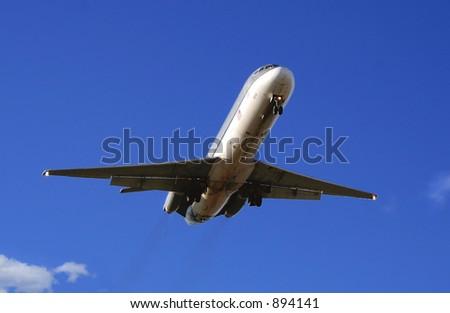 Early morning flight inbound for landing - stock photo