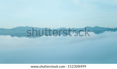 Early Morning Fog in the Mountains - Distant mountain range - stock photo