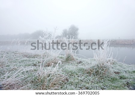 Early morning freezing fog and frost along the River Frome at Eastington, The Severn Vale, Gloucestershire, England, UK - stock photo