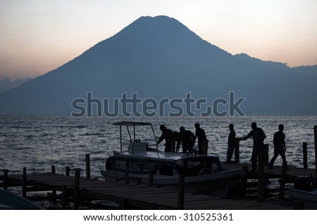 Early morning hustle and bustle, Lago Atitlan, Guatemala - stock photo
