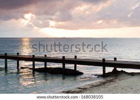 early morning in a beautiful serene tropical beach in southern Belize