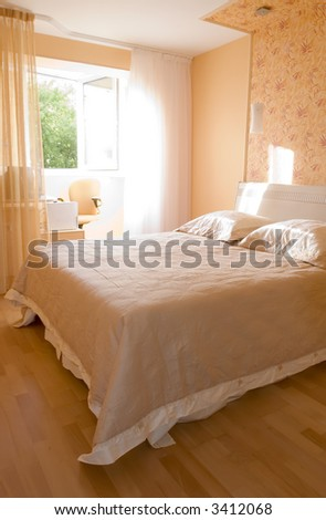 Early morning in a sunny bedroom - stock photo