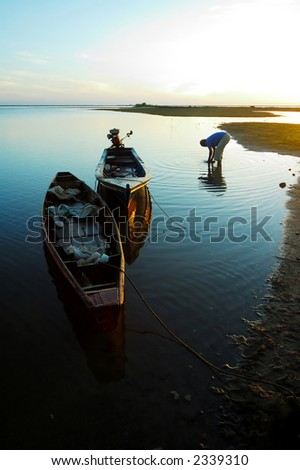 Early morning in fishing village - stock photo