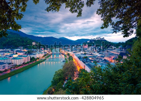 Early morning in Historic city of Salzburg with Festung Hohensalzburg (unesco heritage) and Salzach river. Dramatic Surise in Austria, Europe. Artistic style post processed photo. - stock photo