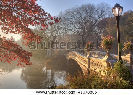Early morning in the fog in Central Park New York City by the bow bridge - stock photo