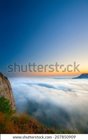 Early Morning in the mountains and clouds with fog in the valley. Natural composition - stock photo