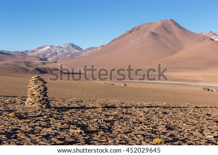 Early morning in the Salvador Dali Desert, stone towers and mountains in the background, Dali Valley , Bolivia, South America