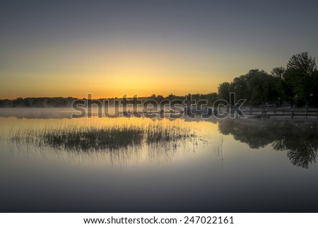 Early Morning Lake Haze - stock photo