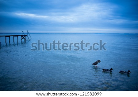 Early morning landscape of the lake Garda in Italy - stock photo