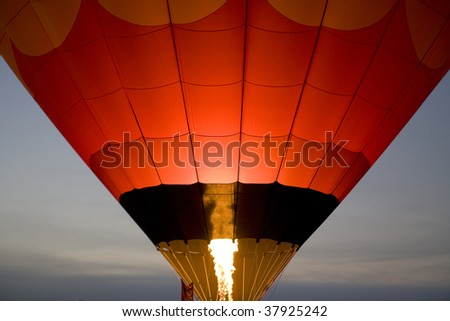 Early Morning Launch with bright flame from Balloon Burner - stock photo