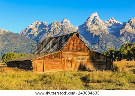Early Morning Light and Shadow on World Famous Moulton Barn with Teton Mountains in Background.  Grand Teton National Park, Wyoming. - stock photo