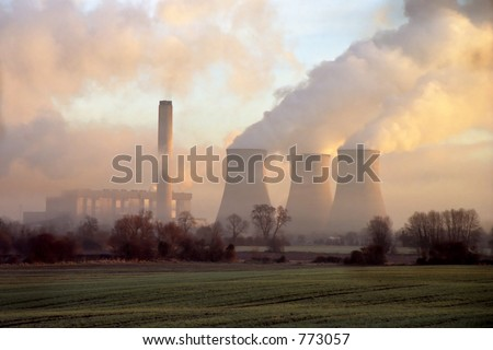 Early morning light on electrical power station - stock photo