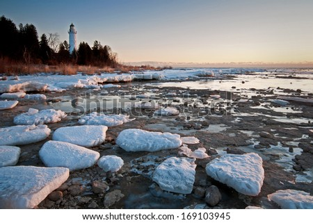Early morning light on the Cana Island Lighthouse in Door County, Wisconsin. - stock photo
