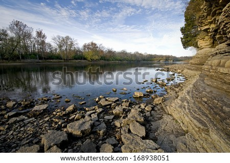 Early morning light on the rocky shoreline of the Kankakee River at Kankakee River State Park, Will County, Illinois. - stock photo