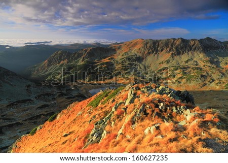 Early morning light over the mountains - stock photo
