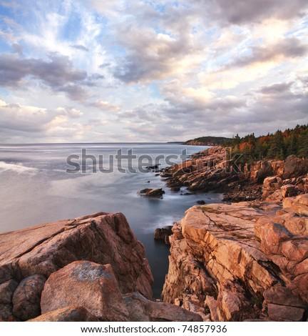Early Morning Light Warms The Rugged Acadia Seacoast, Acadia National Park, Maine, USA - stock photo