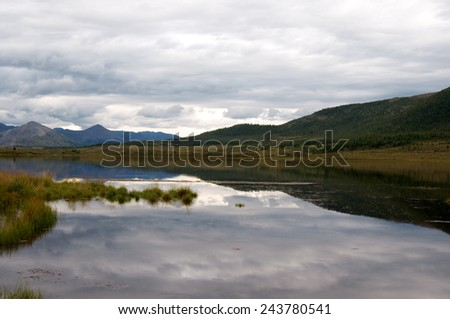 early morning mist over the lake  - stock photo