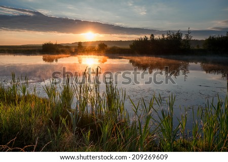 Early morning on a lake in Russia. - stock photo