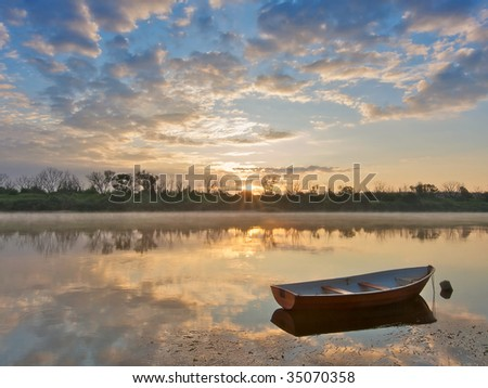 Early morning on a river. Landscape with boat - stock photo