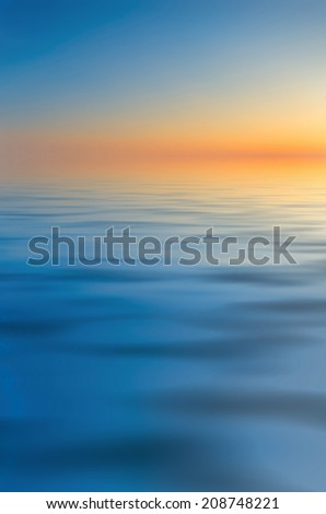 Early morning over the sea. Calm sea and soft dawn - stock photo