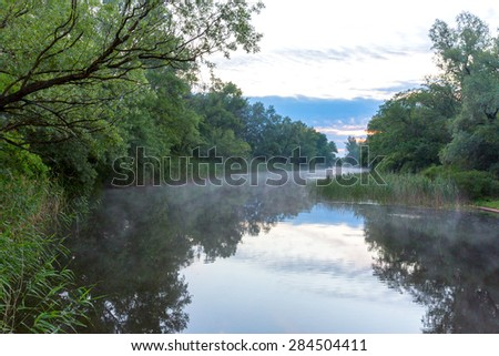 Early morning scene on river - stock photo
