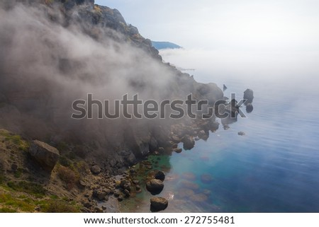 early morning sea bay in a mist - stock photo
