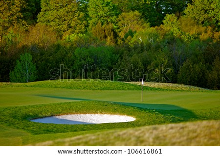 Early morning spring scene of a beautiful idyllic golf course in vibrant colors. - stock photo