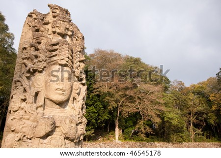 Early morning sunlight on Stela A at the ancient Mayan city of Copan. Honduras, Central America. - stock photo