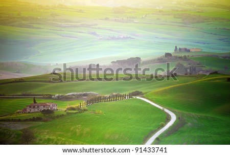 Early morning , sunlight shines on Tuscany hill with thin haze. - stock photo