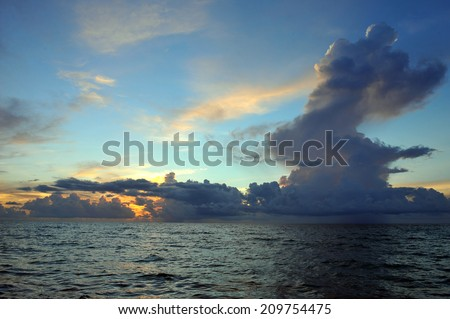 Early morning sunrise over Miami Beach skyline with tropical clouds at horizon - stock photo