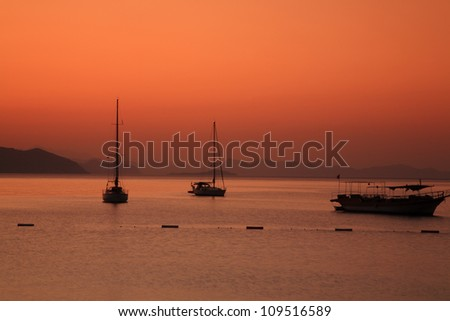 Early morning sunrise over the sea in Turunc Turkey - stock photo