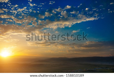 Early morning, the sun rises, mountain. natural landscape - stock photo