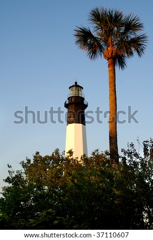Early Morning Tybee Island Lighthouse Vertical With Copy Space - stock photo