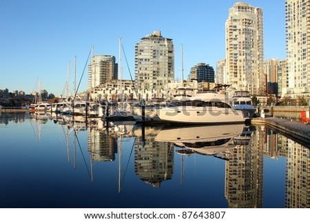Early morning view of a False Creek marina and Yaletown condominiums in downtown Vancouver. British Columbia, Canada.