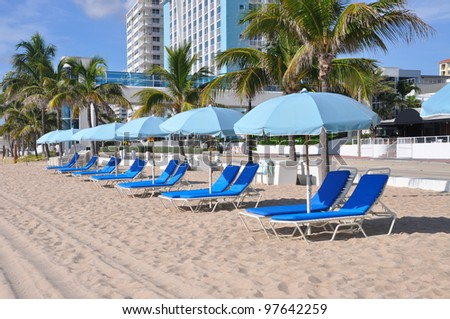 Early Morning View of Lounge Chairs Umbrellas on sandy beach in Fort Lauderdale Florida