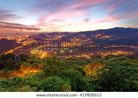 Early morning view of Taipei Xin-Dian water purification plant in a beautiful foggy valley under dramatic dawning sky ~ A water treatment plant in a magnificent surrounding at sunrise - stock photo