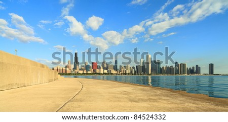 Early morning view of the beautiful downtown Chicago skyline as seen from the Lakeshore Trail along Lake Michigan. - stock photo