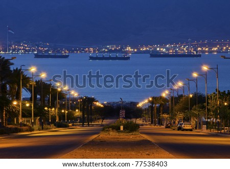 Early morning view on the Red Sea and port Aqaba from the longest street of Eilat city, Israel - stock photo