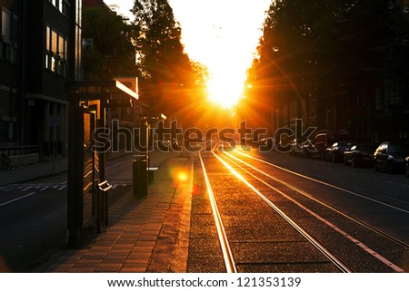 Early morning, waiting at the bus stop in Amsterdam, Netherlands - stock photo