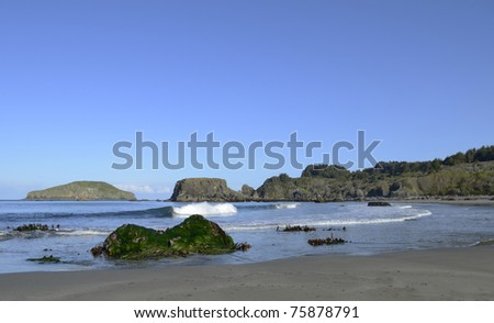 Early morning wave breaking during a minus tide - stock photo