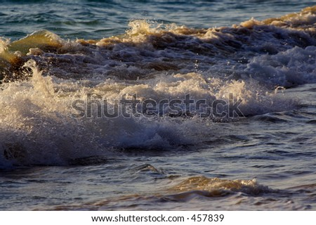 Early morning waves at Waimanalo Beach. - stock photo