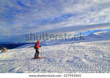 Early morning with ski mountaineer on snow covered slope on the mountain - stock photo