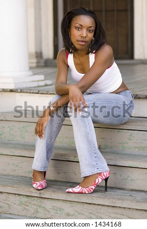 Early 20s African American woman - emotional portrait shots - stock photo
