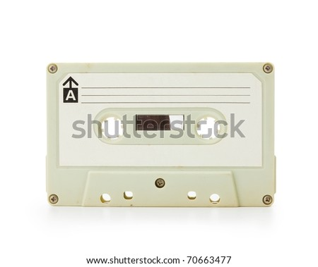 Early 70's cassette tape isolated on white with slight reflection. - stock photo