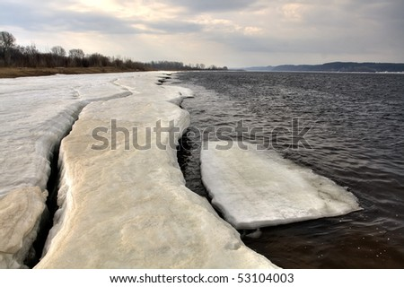 Early spring. Ice on river bank Kama. Russia, the Udmurt republic. - stock photo