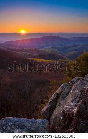 Early spring sunset over the Appalachian Mountains from Bearfence Mountain, located on the Appalachian Trail in Shenandoah National Park, Virginia. - stock photo